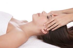 Woman having an Aromatherapy massage by beauty therapist