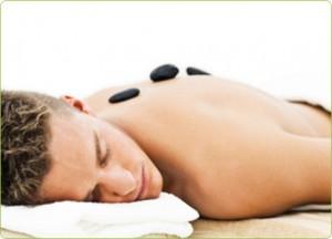 Man having a Hot Stone Massage at beauty salon